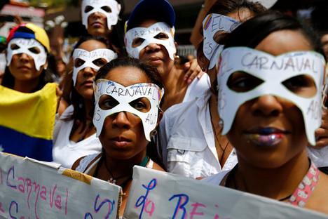 VenezuelaProtestersWearingCarnivalMasks2014-03-06.jpg